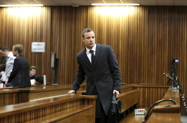 Oscar Pistorius arrives in court on the third day of his trial at the high court in Pretoria, South Africa, Tuesday, March 5, 2014. Pistorius is charged with murder for the shooting death of his girlfriend, Reeva Steenkamp, on Valentine's Day in 2013. (AP Photo/Siphiwe Sibeko, Pool)