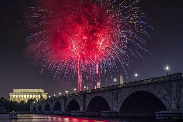 <p>Fireworks burst over the Memorial Bridge during Independence Day celebrations on the National Mall in Washington, Tuesday, July 4, 2017. (AP Photo/J. David Ake) </p>