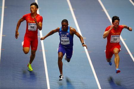 FILE PHOTO: Christian Coleman of the U.S. in action during the Men's 60m Final with China's Bingtian Su and Zhenye Xie at the IAAF World Indoor Championships in Birmingham, Britain, March 3, 2018. REUTERS/Phil Noble/File Photo