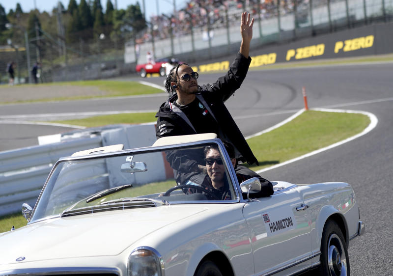 Mercedes driver Lewis Hamilton of Britain waves to the crowd during the drivers parade ahead of the Japanese Formula One Grand Prix at Suzuka Circuit in Suzuka, central Japan, Sunday, Oct. 13, 2019. (AP Photo/Toru Hanai)