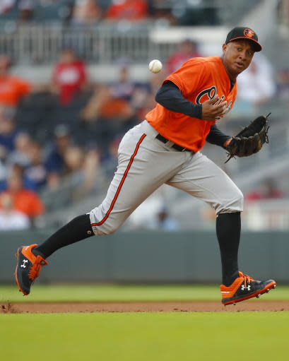 Baltimore Orioles second baseman Jonathan Schoop fails to come up with a ground ball in the eighth inning of a baseball game against the Atlanta Braves, Saturday, June 23, 2018, in Atlanta. (AP Photo/Todd Kirkland)