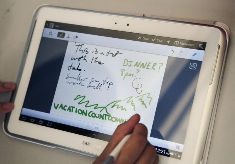 In this Aug. 14, 2012 photo, Samsung's new Galaxy Note 10.1 tablet is demonstrated in New York. Samsung Electronics Co. will start selling the new tablet in the U.S. Thursday, Aug. 16, 2012, in its latest effort to compete with Apple's dominant iPad. (AP Photo/Mark Lennihan)