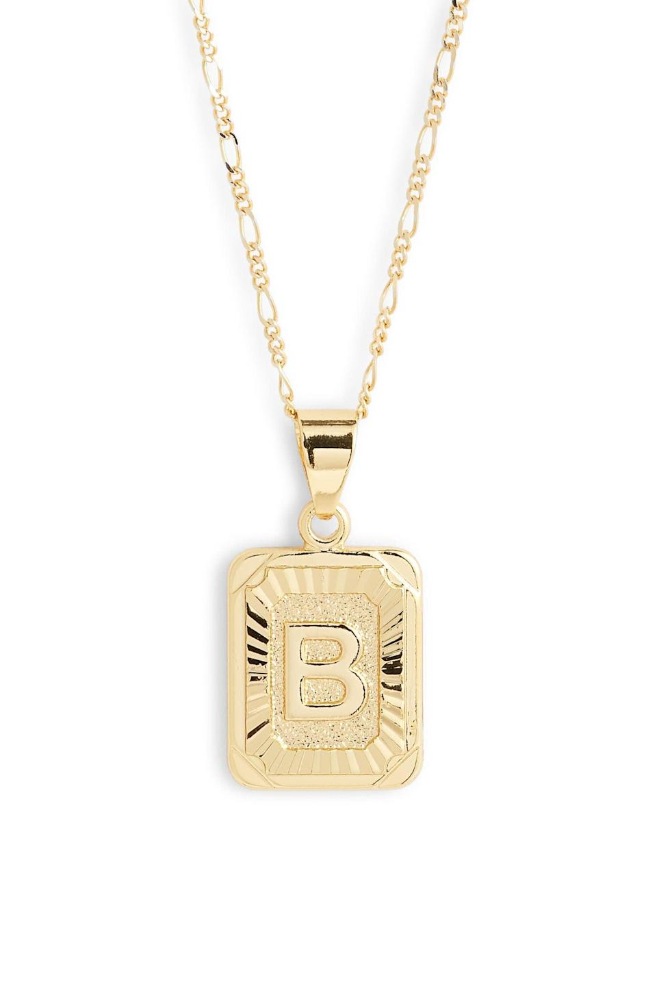 "<p>We love the design of this <a href=""https://www.popsugar.com/buy/Bracha-Initial-Pendant-Necklace-532947?p_name=Bracha%20Initial%20Pendant%20Necklace&retailer=shop.nordstrom.com&pid=532947&price=52&evar1=fab%3Aus&evar9=36291197&evar98=https%3A%2F%2Fwww.popsugar.com%2Ffashion%2Fphoto-gallery%2F36291197%2Fimage%2F47027894%2FBracha-Initial-Pendant-Necklace&list1=shopping%2Choliday%2Cwinter%2Cgift%20guide%2Cwinter%20fashion%2Choliday%20fashion%2Cfashion%20gifts&prop13=api&pdata=1"" rel=""nofollow noopener"" class=""link rapid-noclick-resp"" target=""_blank"" data-ylk=""slk:Bracha Initial Pendant Necklace"">Bracha Initial Pendant Necklace</a> ($52).</p>"