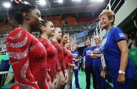 2016 Rio Olympics - Gymnastics training - Rio Olympic Arena - Rio de Janeiro, Brazil - 04/08/2016. (From L) Simone Biles (USA) of USA, Laurie Hernandez (USA) of USA, Madison Kocian (USA) of USA, Gabrielle Douglas (USA) of USA (Gabby Douglas) and Alexandra Raisman (USA) of USA (Aly Raisman) speak to team coordinator Martha Karolyi (R) during training. REUTERS/Damir Sagolj