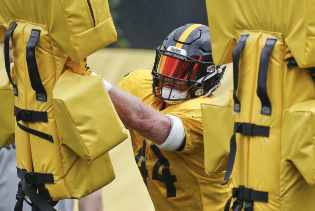 "In this photo from June 13, 2018, Pittsburgh Steelers linebacker Tyler Matakevich goes through drills during an NFL football practice in Pittsburgh. Steelers coach Mike Tomlin gave Tyler Matakevich the nickname ""Dirty Red"" when the Pittsburgh Steelers linebacker was a rookie as a tribute to his mane of red hair and his relentless play. Matakevich enters his third season as a leading candidate to replace injured teammate Ryan Shazier. (AP Photo/Keith Srakocic)"