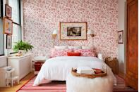 <p>Take a cue from top designers and have fun layering patterns. Here, a vibrant floral accent wall and complementary pillows, in addition to a striped area rug, steal the show.</p>