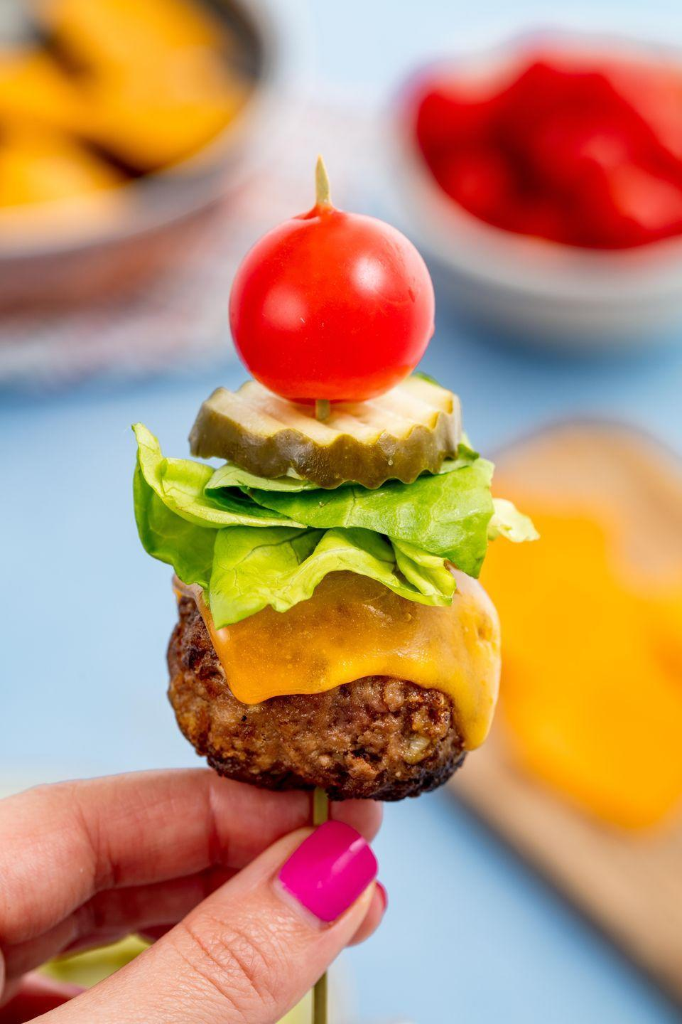 """<p>Sliders, who?</p><p>Get the recipe from <a href=""""https://www.delish.com/cooking/recipe-ideas/a47984/cheeseburger-skewers-bunless-burgers-recipe/"""" rel=""""nofollow noopener"""" target=""""_blank"""" data-ylk=""""slk:Delish"""" class=""""link rapid-noclick-resp"""">Delish</a>.</p>"""
