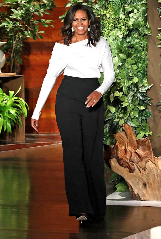 """<p><em>Can you PLEASE tell me about these black slacks that Lady Michelle Obama wore on Ellen today?! Please?! -- Dietra</em>  The former First Lady looked classy as ever when she appeared on <em>Ellen</em> in honor of the TV host's birthday wearing <a rel=""""nofollow"""" href=""""https://www.rolandmouret.com/product/resort-2018/axon-trouser/blk"""">wide leg trousers from Roland Mouret</a>. </p>"""