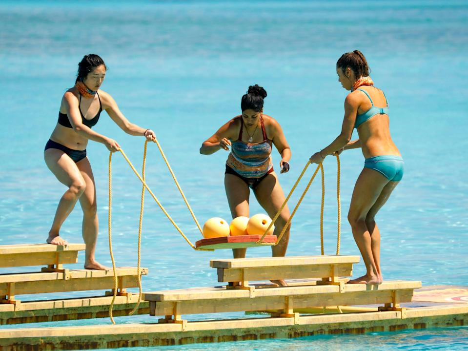 Kellee Kim, Karishma Patel, and Noura Salman competing in a challenge in the water