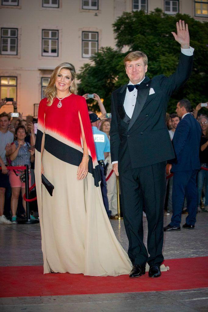 <p>We've mostly seen solid-coloured cape dresses over the years, but Queen Maxima made a bold choice with a striped version in 2017. The Queen wore this vibrant look with King Willem-Alexander, as the pair attended a concert in Lisbon, Portugal. <br></p>