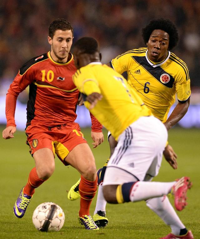 Belgium's Eden Hazard, left, battles for the ball with Colombia's Pablo Armero, center, and Carlos Sanchez, right, during a friendly soccer match at the King Baudouin stadium in Brussels on Thursday, Nov. 14, 2013. (AP Photo/Geert Vanden Wijngaert)