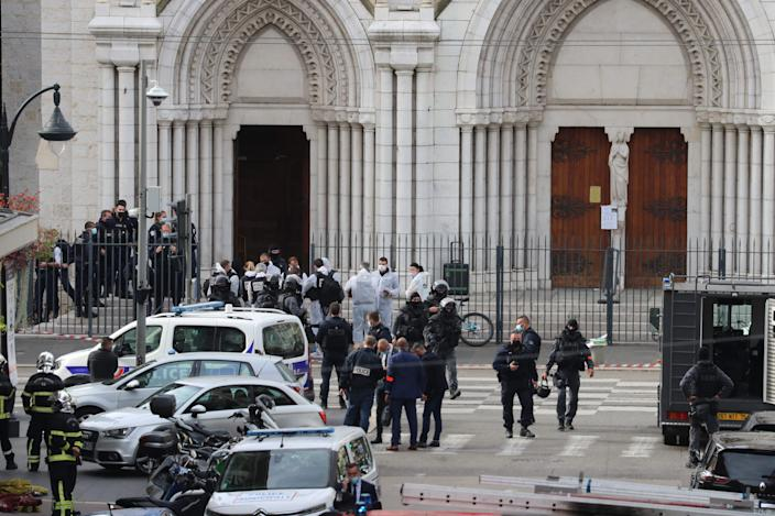 French members of the elite tactical police unit RAID leave after searching the Basilica of Notre-Dame de Nice after a knife attack in Nice on October 29, 2020, as forensics officers prepare to enter. France's national anti-terror prosecutors said Thursday they have opened a murder inquiry after a man killed three people at a basilica in central Nice and wounded several others. The city's mayor, Christian Estrosi, told journalists at the scene that the assailant, detained shortly afterwards by police.