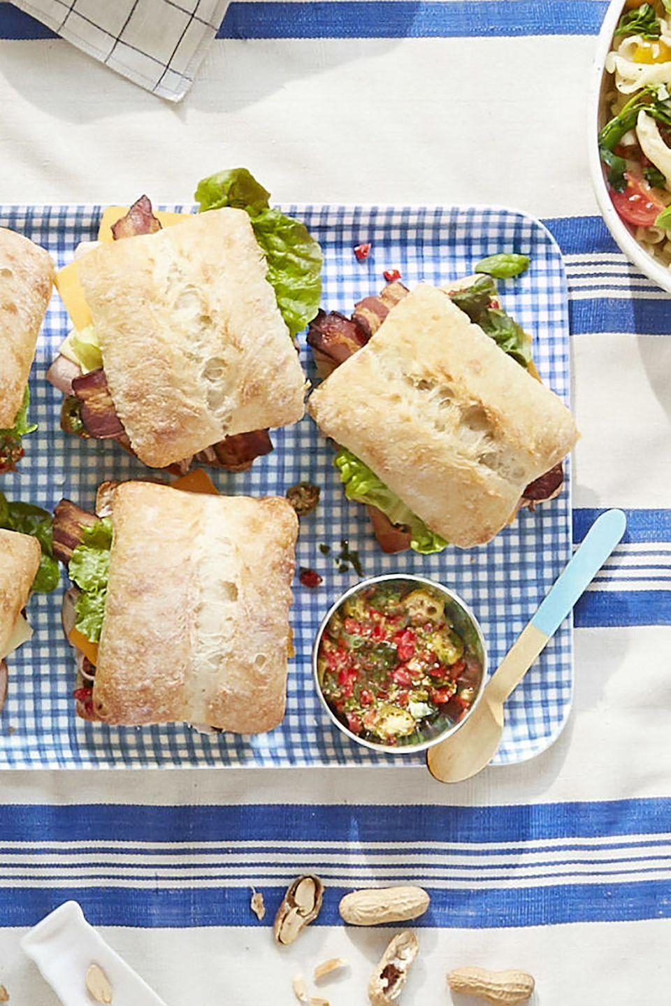 """<p>Topped with turkey bacon and Cheddar cheese, this sweet and salty sandwich is super satisfying.</p><p><strong><a href=""""https://www.countryliving.com/food-drinks/recipes/a42460/pimiento-salad-club-sandwiches-recipe/"""" rel=""""nofollow noopener"""" target=""""_blank"""" data-ylk=""""slk:Get the recipe"""" class=""""link rapid-noclick-resp"""">Get the recipe</a>.</strong> </p>"""