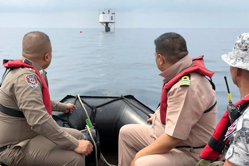 Thai naval officers from the Third Naval Area Command and Marine policemen inspecting a 'Seastead'. (EPA)