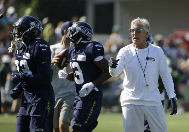 Seattle coach Pete Carroll had to help restore order at training camp on Thursday after a fight broke out between his offensive and defensive linemen. (AP)