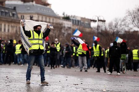 Yellow vest protests hit with police water cannon tear gas in ParisMore