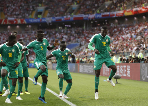 Senegal's Mbaye Niang, right, dances in celebration with his teammates scoring his side's second goalduring the group H match between Poland and Senegal at the 2018 soccer World Cup in the Spartak Stadium in Moscow, Russia, Tuesday, June 19, 2018. (AP Photo/Eduardo Verdugo)