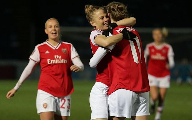 Arsenal forward Vivianne Miedema is congratulated during the 3-0 win at Adams Park - REX