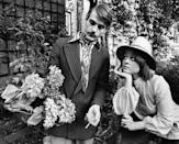 <p>English actor Jeremy Irons inspects a bouquet of hydrangeas from the garden at his Hampstead home in 1974 with his then-girlfriend, Sinead Cusack. </p>