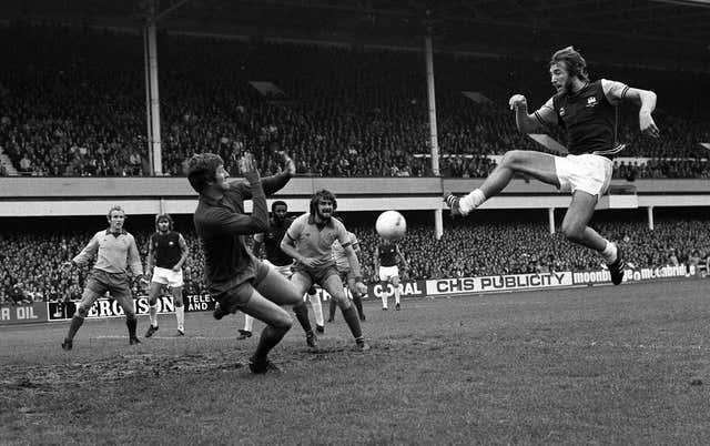 Dai Davies, playing for Everton, saves from West Ham captain Billy Bonds