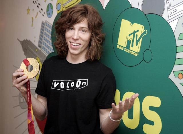 "<p>Olympic snowboarder Shaun White holds his gold metal backstage during MTV's ""Total Request Live"" show at the MTV Times Square Studios, Wednesday, Feb. 22, 2006 in New York. White won the halfpipe competition last week in Italy. (AP Photo/Jeff Christensen) </p>"