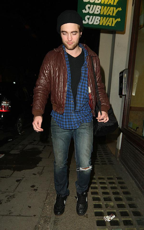 """Twilight"" heartthrob Robert Pattinson dons a pair of ripped pants for a night out on the town in London. Goff/<a href=""http://www.infdaily.com"" target=""new"">INFDaily.com</a> - February 14, 2009"