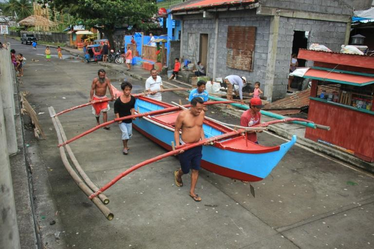 Residents south of Manila prepare for Typhoon Kammuri, as organisers at the Southeast Asian Games say they are 'ready' for the powerful storm