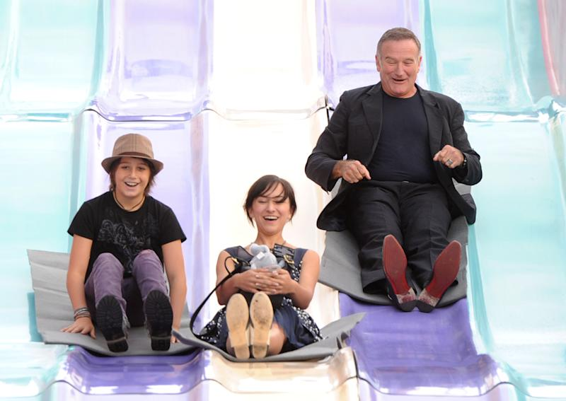 (L-R) Milo Jacob Manheim, actress Zelda Williams and actor Robin Williams attend the Premiere of Warner Bros