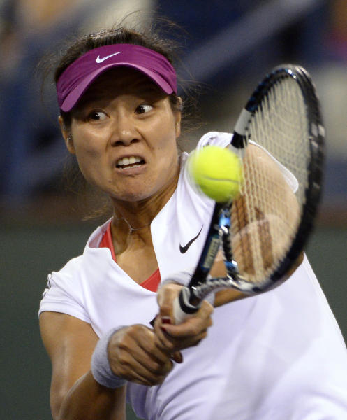 Li Na, of China, returns a shot to Flavia Pennetta, of Italy, at the BNP Paribas Open tennis tournament, Friday, March 14, 2014, in Indian Wells, Calif. (AP Photo/Mark J. Terrill)