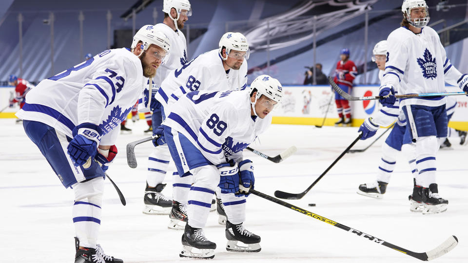 TORONTO, ONTARIO - JULY 28: (L-R) Kyle Clifford #73, Cody Ceci #83 and Nick Robertson #89 of the Toronto Maple Leafs look on during warm-up prior to an exhibition game against the Montreal Canadiens prior to the 2020 NHL Stanley Cup Playoffs at Scotiabank Arena on July 28, 2020 in Toronto, Ontario. (Photo by Mark Blinch/NHLI via Getty Images)