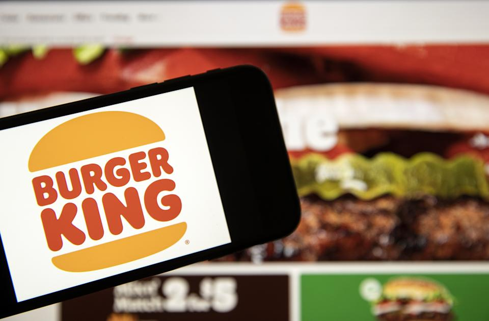 ANKARA, TURKEY - JANUARY 08: In this photo illustration, a laptop screen displays order page of Burger King and a smart phone displays the new logo of it in Ankara, Turkey on January 08, 2021. Burger King unveils new logo making it its first rebrand in over 20 years. (Photo by Ali Balikci/Anadolu Agency via Getty Images)