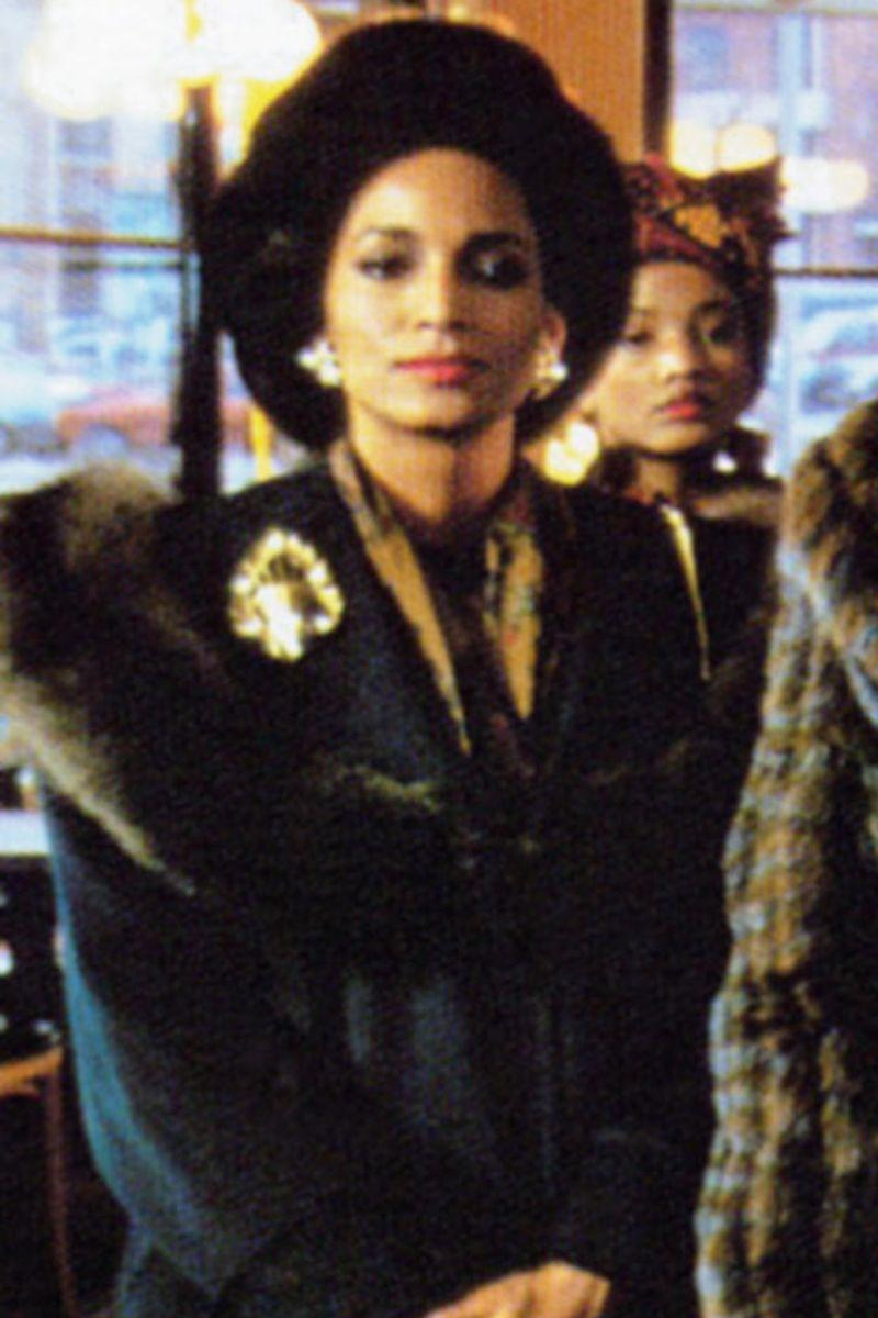"""<p>Prior to joining the cast of the original <em>Coming to America</em>, Sheila Johnson was an accomplished fashion runway and print model for top publications and advertisements; she also had a sitcom career, starring as an extra in <em>Sister, Sister</em> and hit shows like <em>Space Ranger</em> and<em> Criminal Passion.</em> The same year that she played the """"Lady-in-Waiting"""" in the original <em>Coming to America</em> film, she went on to star in <em>Shakedown and Bright Lights, Big City.</em></p>"""