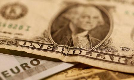 FILE PHOTO: Euro and Dollar banknotes are seen in a picture illustration.