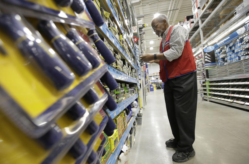 Lowe's swings to 4Q loss on charges, anemic housing market