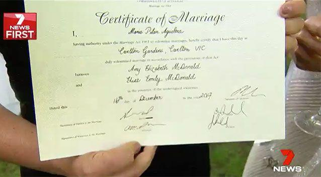 The newly weds got marriage certificates with the word 'groom' erased. Source: 7 News