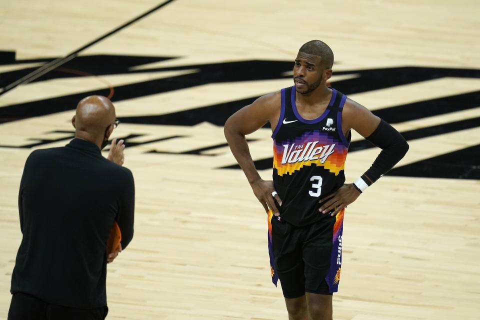 Phoenix Suns guard Chris Paul (3) talks with head coach Monty Williams, left, during the first half of Game 5 of basketball's NBA Finals against the Milwaukee Bucks, Saturday, July 17, 2021, in Phoenix. (AP Photo/Ross D. Franklin)