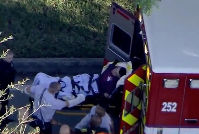 <p>A man who was placed in handcuffs by police is loaded into a paramedic vehicle after a shooting incident at Marjory Stoneman Douglas High School in Parkland, Florida, U.S. February 14, 2018 in a still image from video. (Photo: WSVN.com via Reuters) </p>