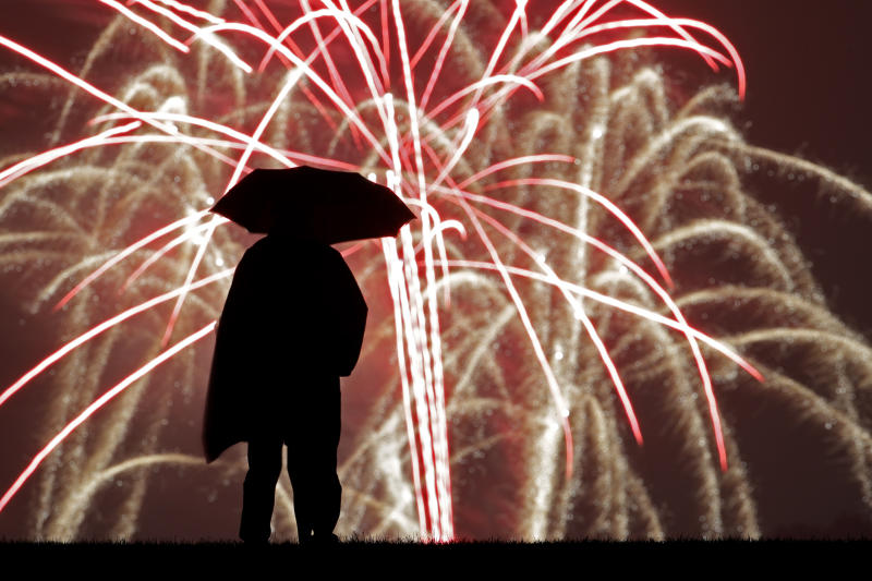 A person watches Independence Day fireworks celebrations from the Liberty Memorial, July 4, 2019, in Kansas City, Mo. (Photo: Charlie Riedel/AP)