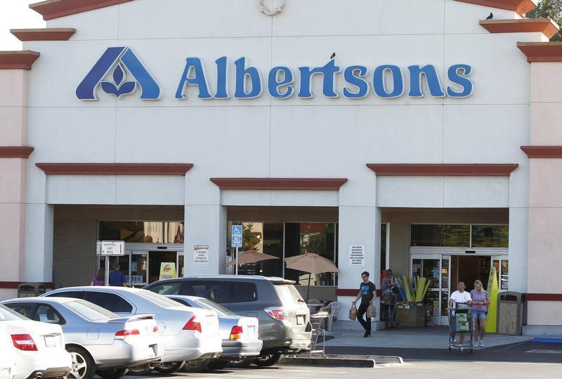 Customers leave an Albertsons grocery store with their purchases in Burbank, California