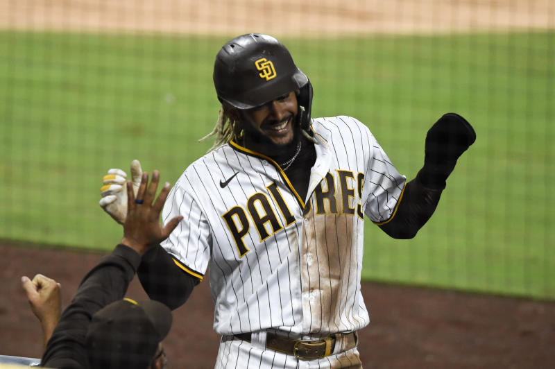 San Diego Padres shortstop Fernando Tatis Jr. (23) celebrates after scoring during the third inning of a baseball game against the Seattle Mariners Saturday, Sept. 19, 2020, in San Diego. (AP Photo/Denis Poroy)