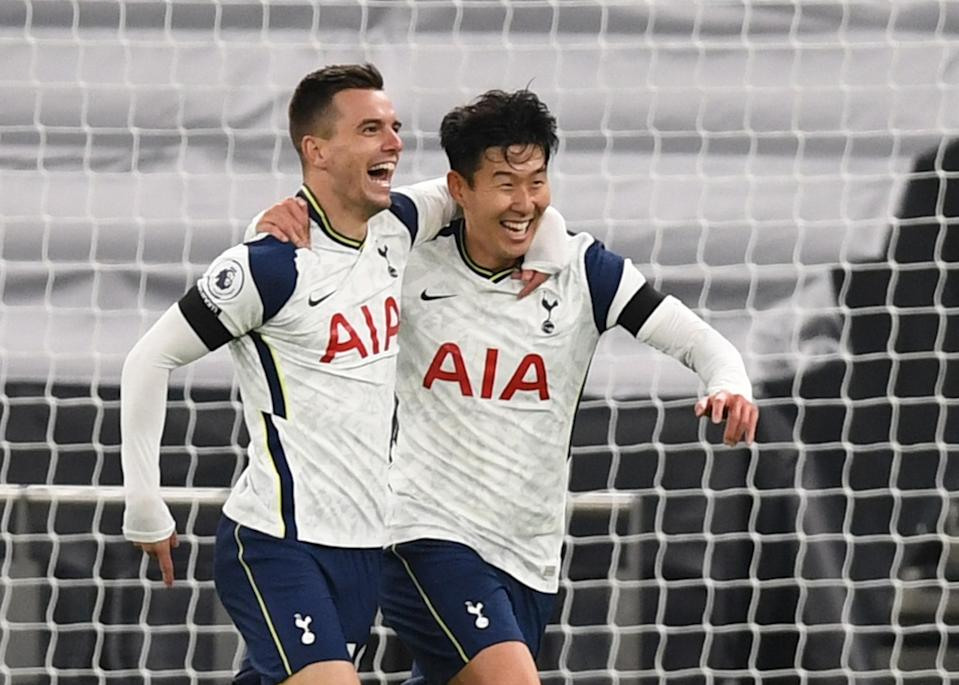 Tottenham Hotspur's Giovani Lo Celso celebrates scoring their second goal against Manchester City with Son Heung-min.