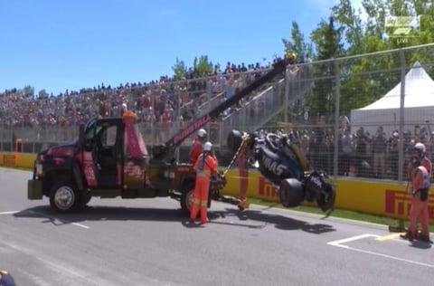 Marshals retrieve Kevin Magnussen's stricken Haas - Credit: Sky Sports F1
