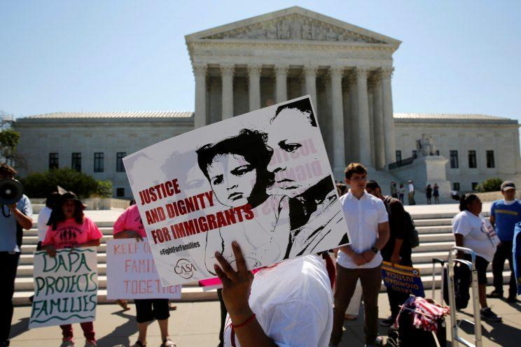 Demonstrators from the immigrant advocacy group CASA march in hopes of a Supreme Court ruling in their favor, June 20, 2016. (Jonathan Ernst/Reuters)