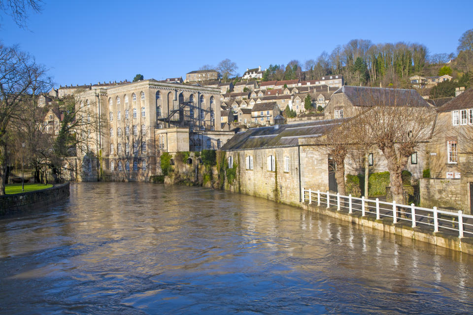 Historic buildings and River Avon, Bradford on Avon, Wiltshire, England (Photo by: Education Images/Universal Images Group via Getty Images)
