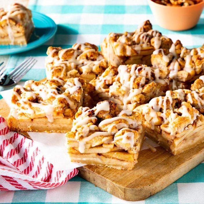 """<p>If you're looking for a bake sale treat or just a tasty after-school snack, look no further than these apple pie bars. They're easy to pack up and delicious to eat! </p><p><a href=""""https://www.thepioneerwoman.com/food-cooking/recipes/a37041566/apple-pie-bars-recipe/"""" rel=""""nofollow noopener"""" target=""""_blank"""" data-ylk=""""slk:Get the recipe."""" class=""""link rapid-noclick-resp""""><strong>Get the recipe.</strong></a></p>"""