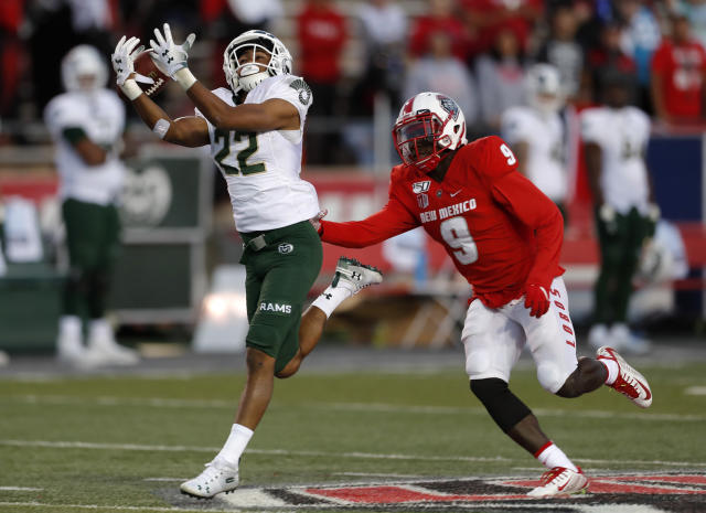 Colorado State wide receiver Dante Wright (22) drops a pass under pressure from New Mexico safety Jerrick Reed (9) during the first half of an NCAA college football game Friday, Oct. 11, 2019, in Albuquerque, N.M. (AP Photo/Andres Leighton)
