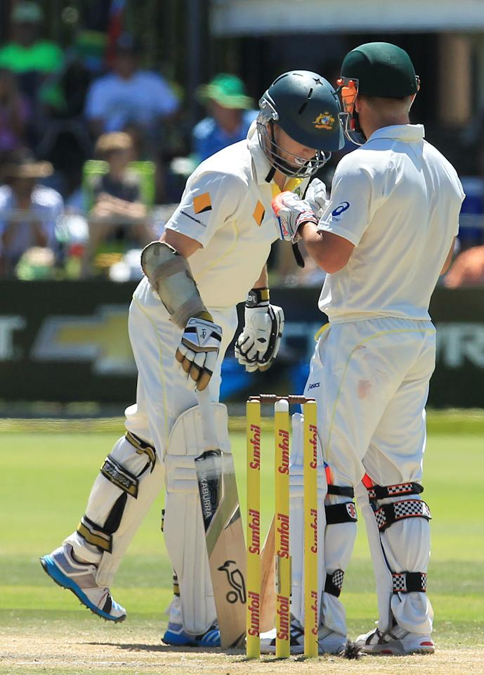 Australia's batsman Chris Rogers, left, has a word with teammate David Warner, right, on the fourth day of their second cricket test match against South Africa at St George's Park in Port Elizabeth, South Africa, Sunday, Feb. 23, 2014. (AP Photo/ Themba Hadebe)