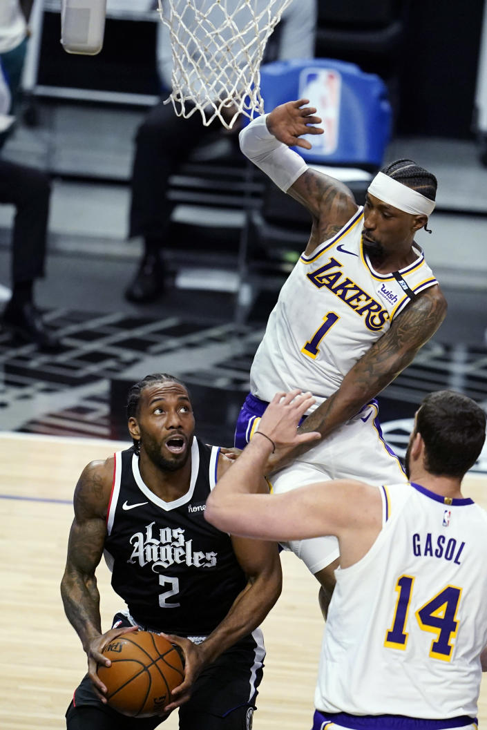 Los Angeles Clippers forward Kawhi Leonard (2) is defended by Los Angeles Lakers guard Kentavious Caldwell-Pope (1) during the first half of an NBA basketball game Sunday, April 4, 2021, in Los Angeles. (AP Photo/Marcio Jose Sanchez)