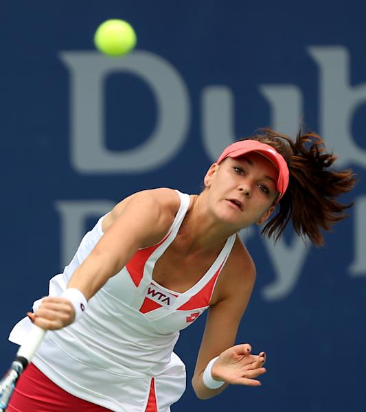 Agnieszka Radwanska of Poland serves to Yulia Putinseva of Kazakhstan during the third day of Dubai Duty Free Tennis Championships in Dubai, United Arab Emirates, Wednesday, Feb. 20, 2013. (AP Photo/Regi Varghese)
