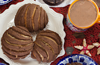 """<p>A <em>panaderia </em>(bread shop) staple, conchas are Mexican sweet loaves topped with sugar and perfectly paired with hot chocolate or a <a href=""""https://www.thedailymeal.com/best-recipes/best-coffee-recipes?referrer=yahoo&category=beauty_food&include_utm=1&utm_medium=referral&utm_source=yahoo&utm_campaign=feed"""" rel=""""nofollow noopener"""" target=""""_blank"""" data-ylk=""""slk:fresh cup of home-brewed coffee"""" class=""""link rapid-noclick-resp"""">fresh cup of home-brewed coffee</a>. </p> <p><strong><a href=""""https://www.thedailymeal.com/recipes/abuelita-conchas-recipe?referrer=yahoo&category=beauty_food&include_utm=1&utm_medium=referral&utm_source=yahoo&utm_campaign=feed"""" rel=""""nofollow noopener"""" target=""""_blank"""" data-ylk=""""slk:For the Abuelita Conchas recipe, click here."""" class=""""link rapid-noclick-resp"""">For the Abuelita Conchas recipe, click here.</a> </strong></p>"""